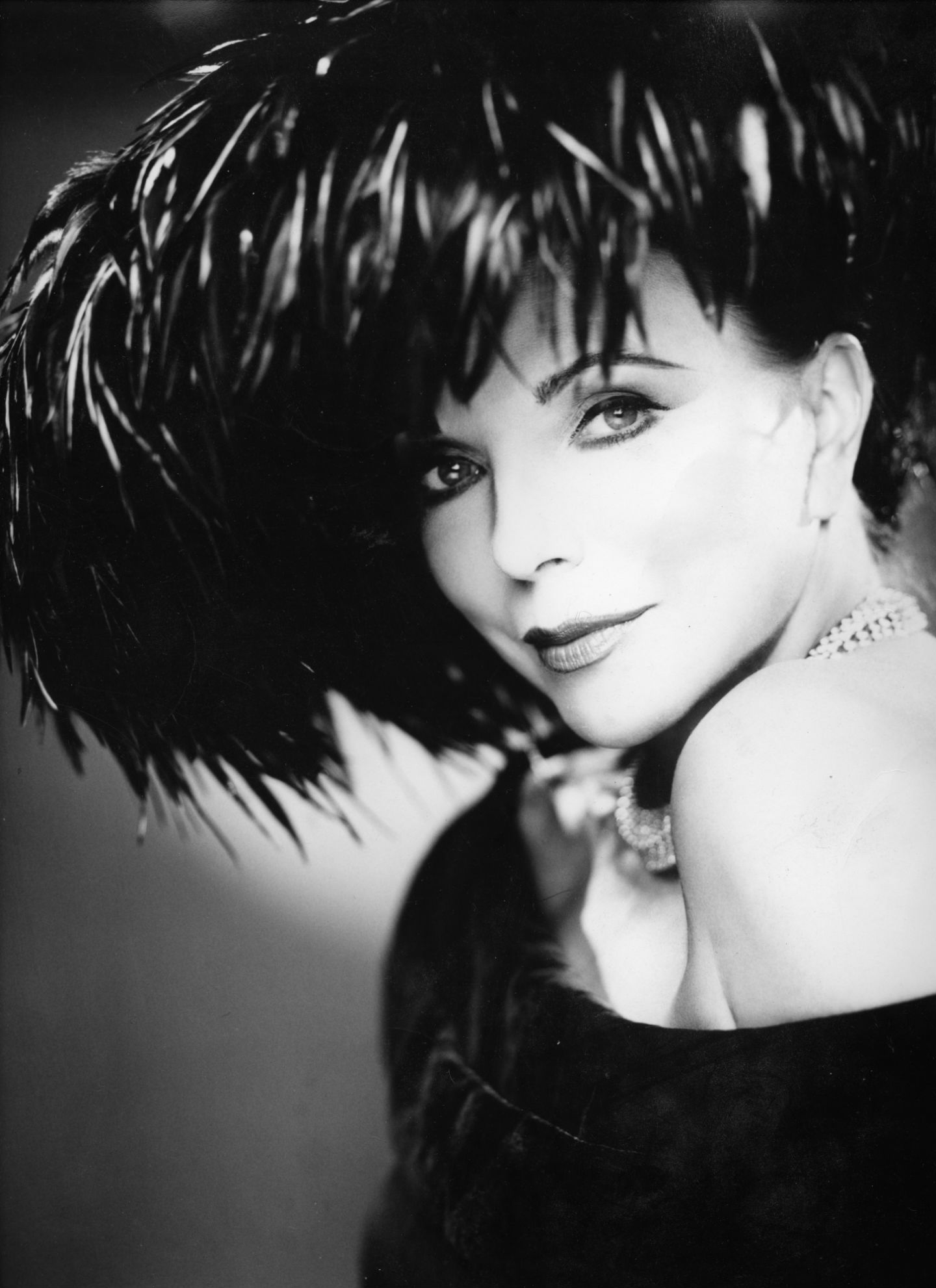 Joan Collins: she was made guest editor of Marie Claire and this picture was for that: an interesting character in a funny sort of way.