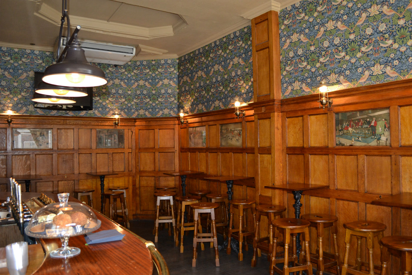 Inside the Scottish Stores today. Note the paneling and original art. Photo: SE