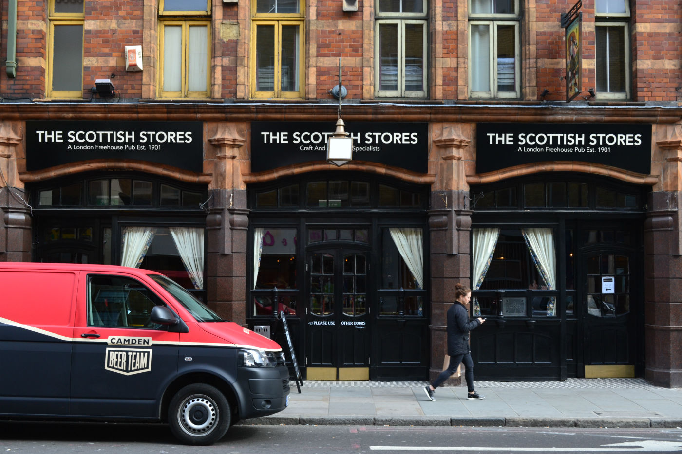 A local brewery fan pulls up to the Scottish Stores. Photo: SE