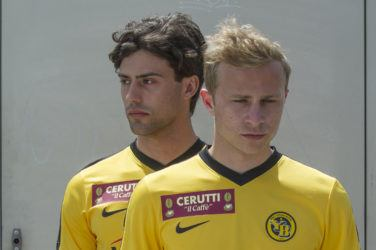 Max Hubacher and Aaron Altras in yellow football kit in Mario
