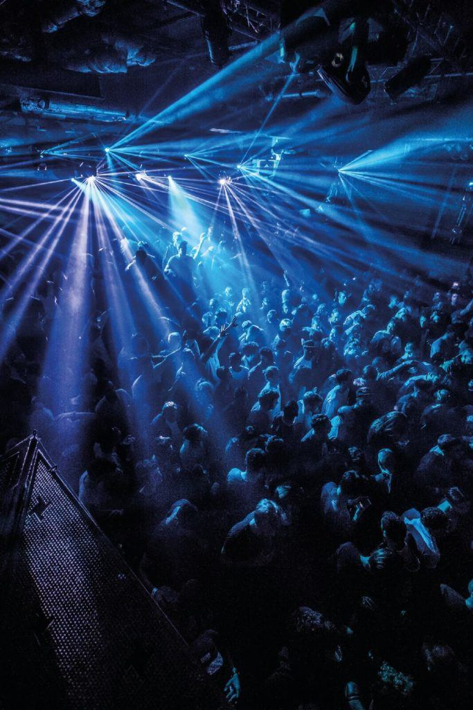 Strobe lights over a crowd in Fabric